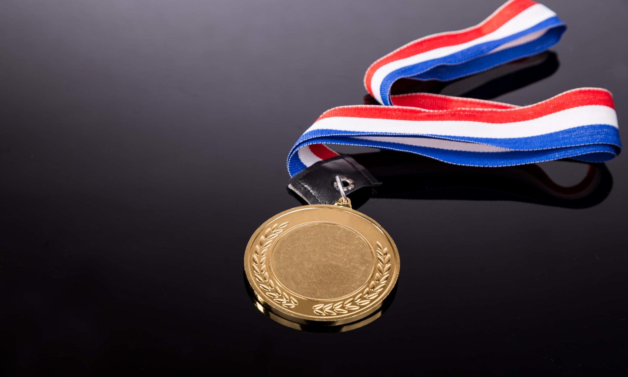 generic-sporting-event-gold-medal-with-red-and-P725MK7-min