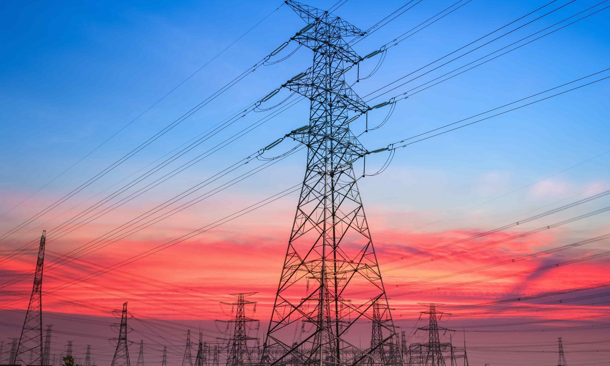 electricity-pylon-in-sunset-min